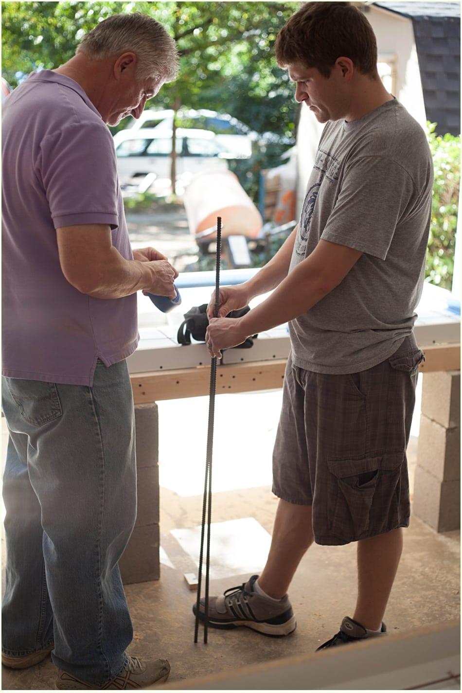 Measuring a piece of rebar for DIY concrete countertops.