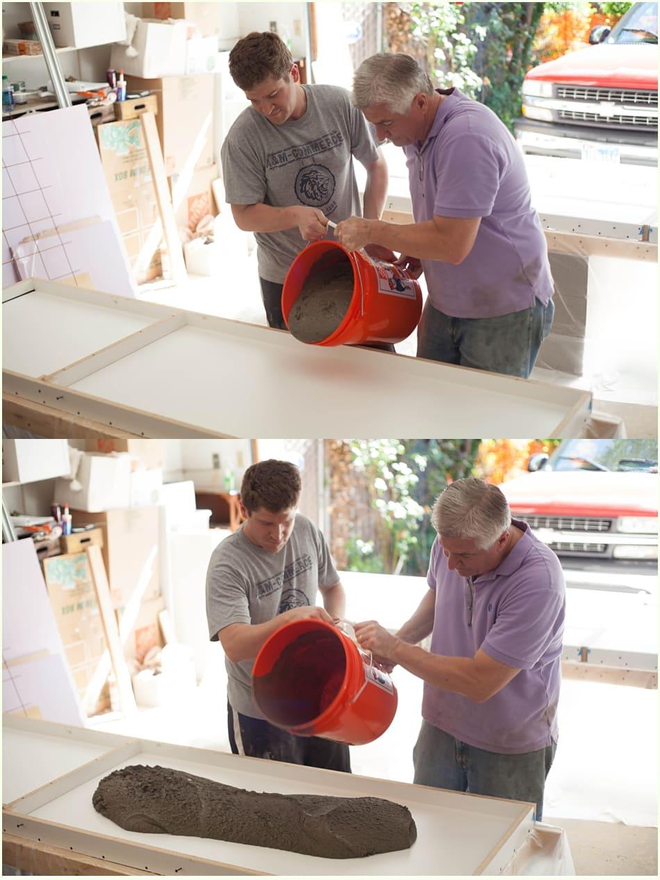 Pouring concrete mixture into countertop mold.
