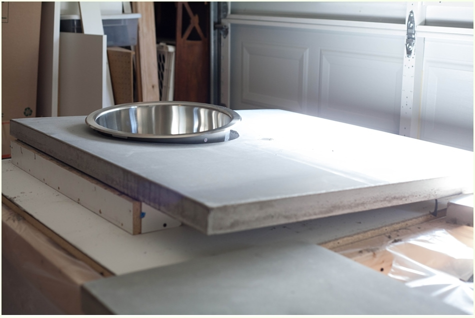A DIY concrete countertop with a stainless steel sink insert.