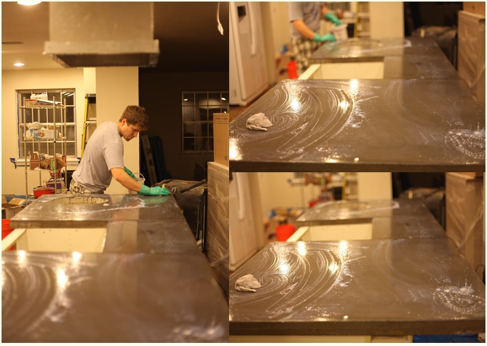 Sealer mix being applied with a clean rag to cement countertops.