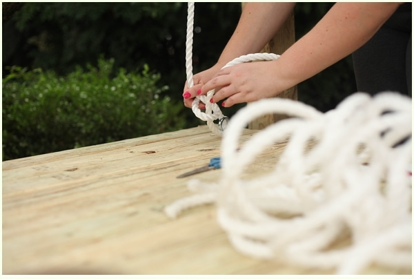 Woman tying a bowline knot with rope to help suspend a hanging bed