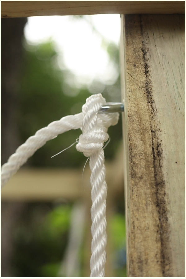 Bowline knot with rope in an eye bolt holding up a hanging bed