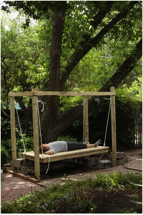 How to build a hanging bed easy diy outdoor swing bed to complete woman relaxing on a hanging bed outdoors under a tree solutioingenieria Gallery