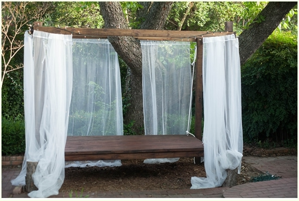 How to build a hanging bed easy diy outdoor swing bed to complete hanging bed outdoors with white mosquito netting under a large oak tree solutioingenieria Gallery