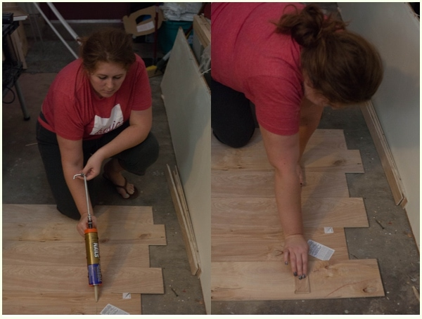Liquid nails being used to glue together plywood strips.