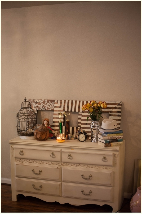 A blank wall above a chalk painted dresser.