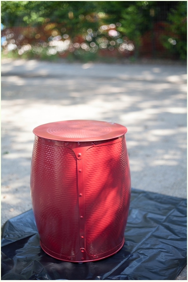 A red metal stool