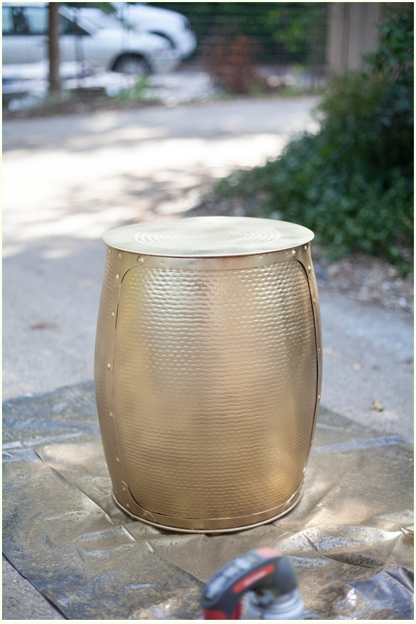 A gold metal stool