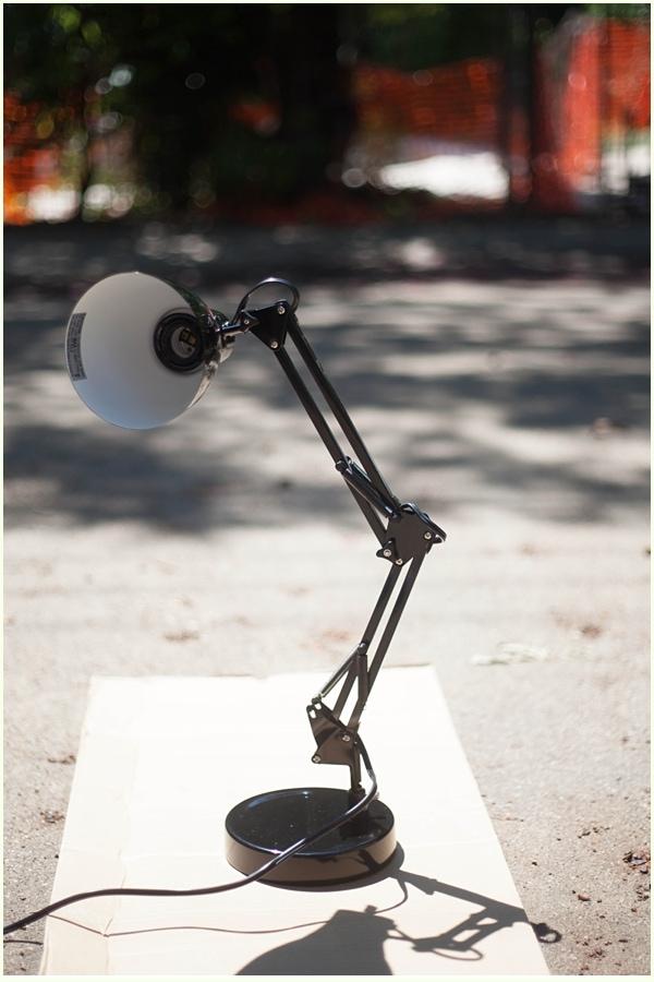 A black metal desk lamp