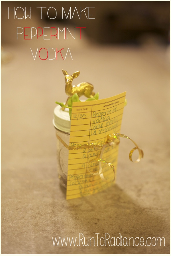 DIY peppermint vodka in a gold and mint Christmas decorated mason jar