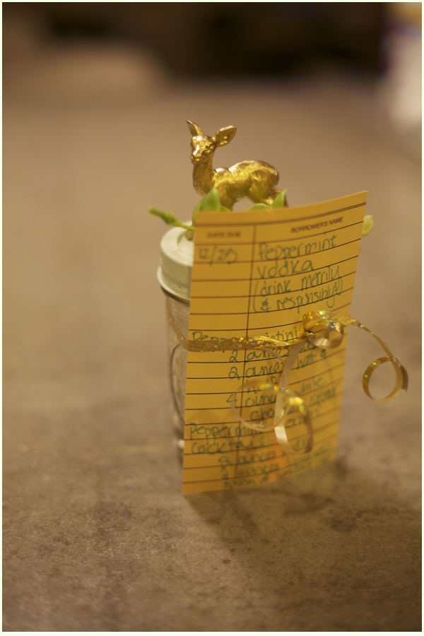 Christmas decorated mason jar with library card catalog style paper to house recipes- how to use peppermint vodka