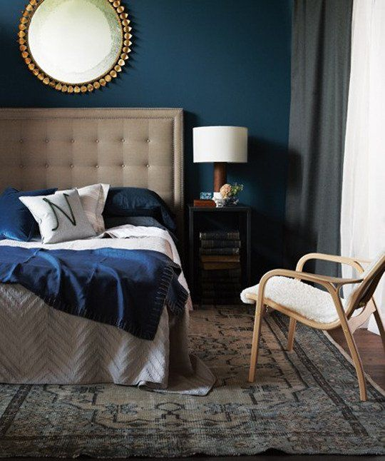 navy bedroom with gold