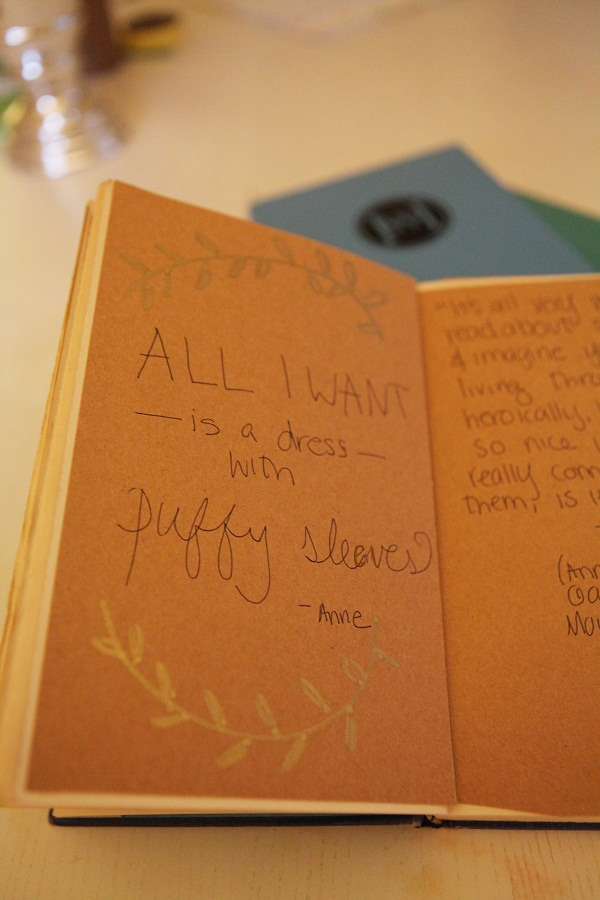 Anne of Green Gables quotes written on brown craft paper.