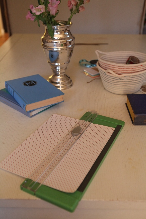 patterned paper being cut by a paper trimmer