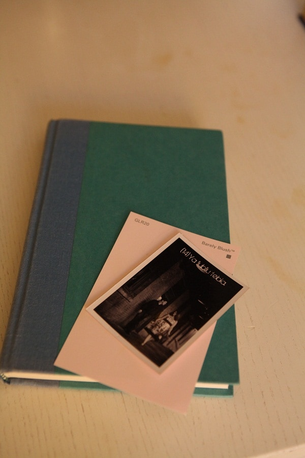 A wedding photo laid on top of a vintage book.