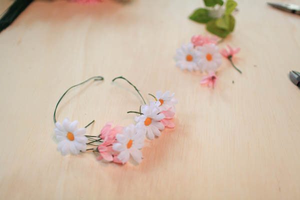 Multicolored silk flowers on a DIY flower crown.