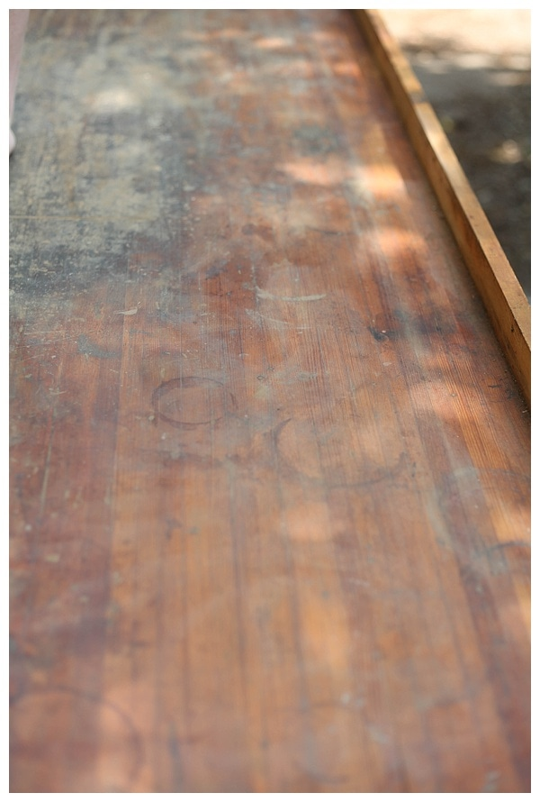 Surface of old work table in the process of being sanded.