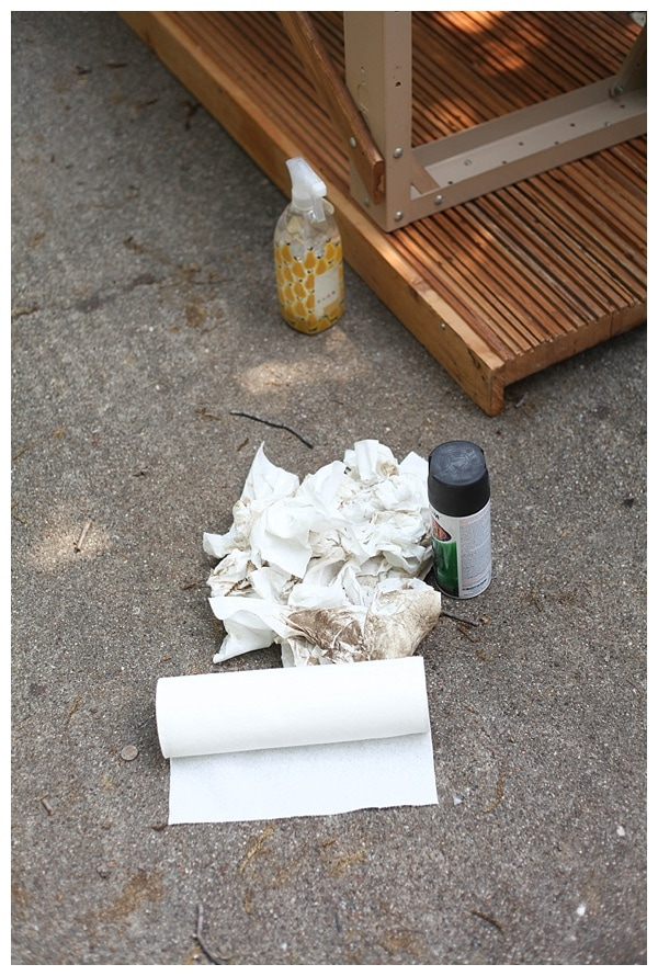 Pile of dirty paper towels, cleaning spray and a can of black spray paint.