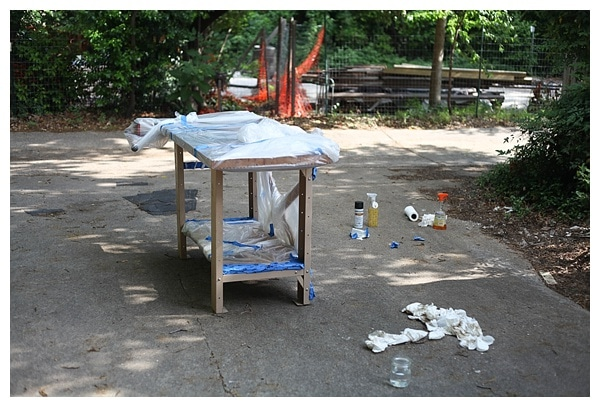 Vintage work bench with only metal legs exposed for painting.
