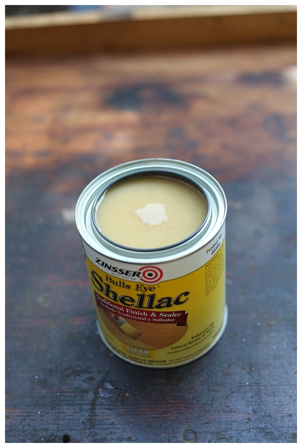 Opened can of shellac based sealer for wooden work bench DIY project.