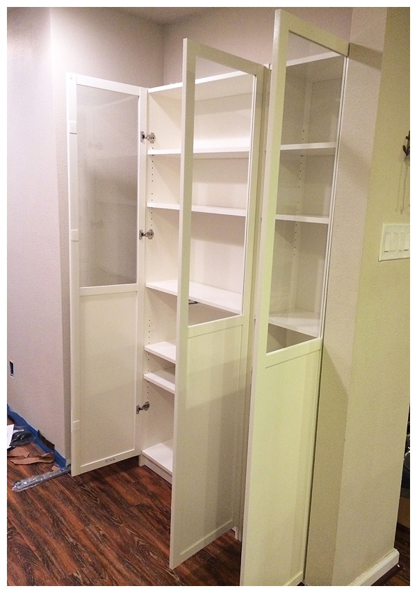 Ikea billy bookcase with doors opened in a kitchen for a freestanding pantry