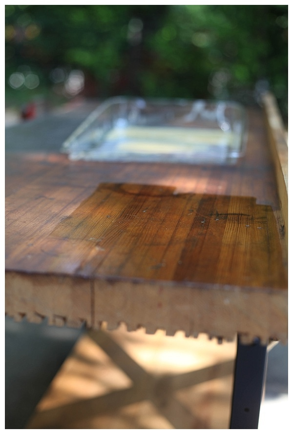 Shiny shellac-coated surface of a vintage workbench.