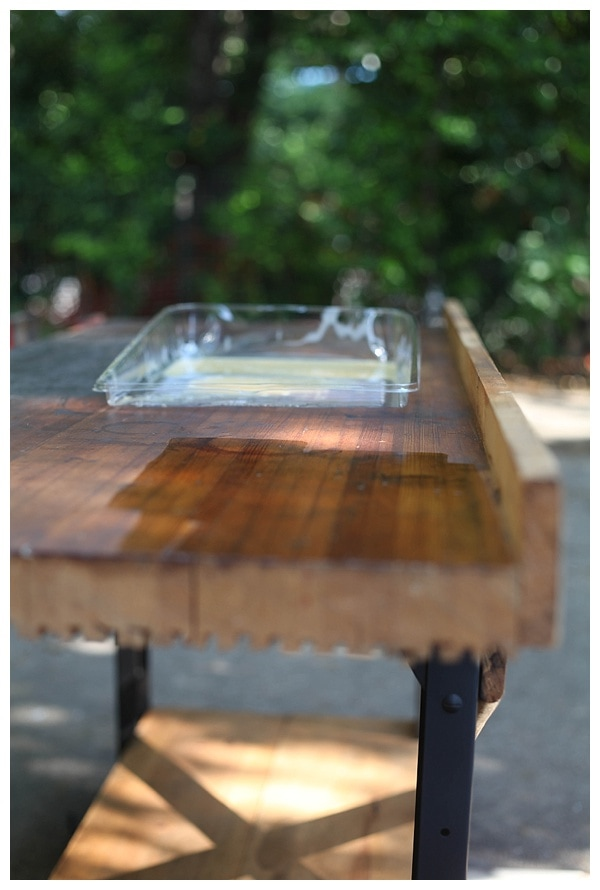 Shellac applied to the top of an old wooden work table.