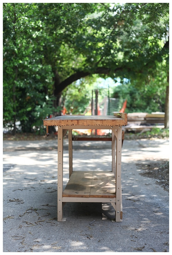 A vintage work table sitting outside.