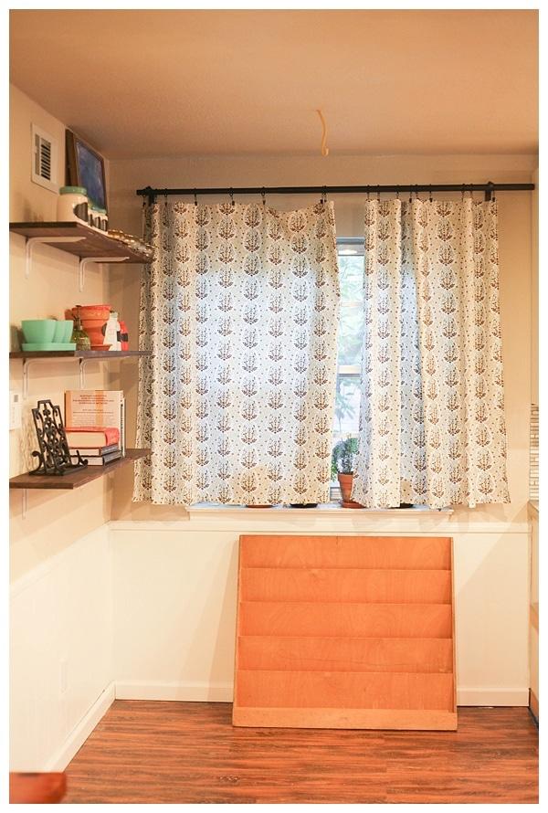 Kitchen window with book shelf below.