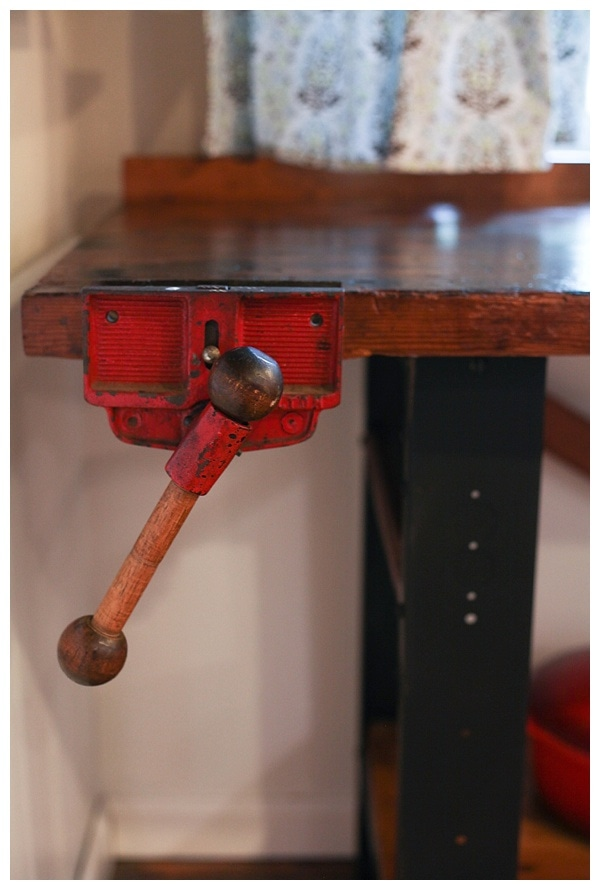 Vintage clamp on old wooden workbench that has been restored.