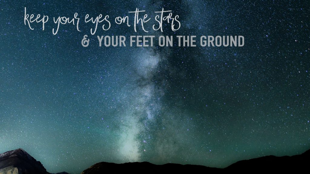 Galaxy wallpaper with quote keep your eyes on the stars and your feet on the ground.