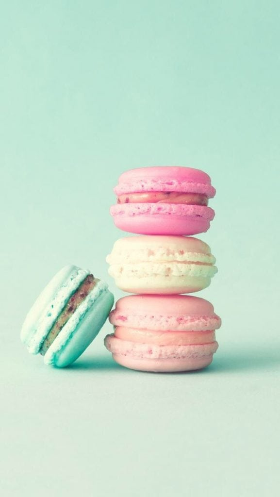 cute wallpapers with a stack of pastel macarons on a mint pastel background