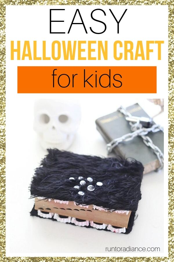 Halloween crafts - one book with fur and google eyes and plastic fangs, another book with chains and a lock.