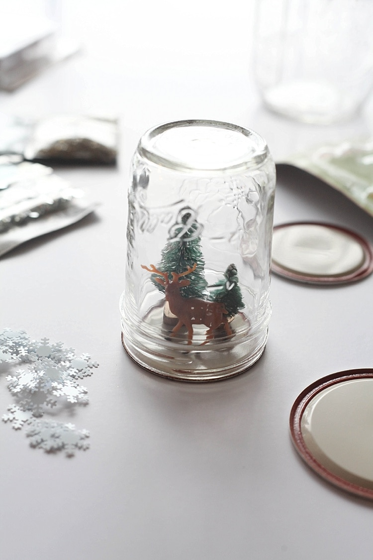 Mason jar snow globe - Dry fit of deer and Christmas tree in mason jar