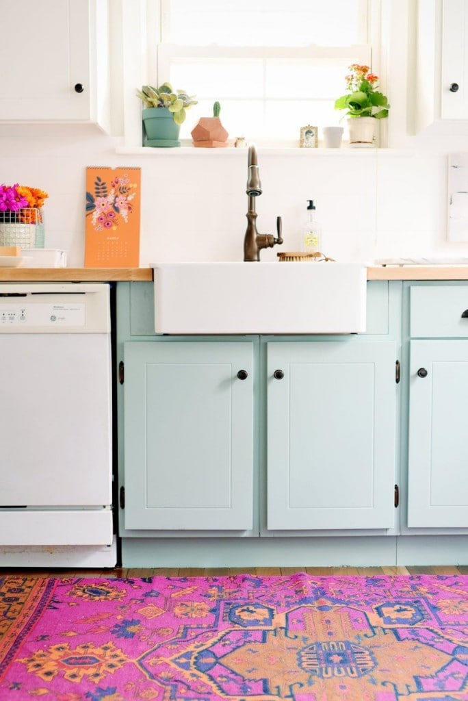 Mint cabinets and white appliances