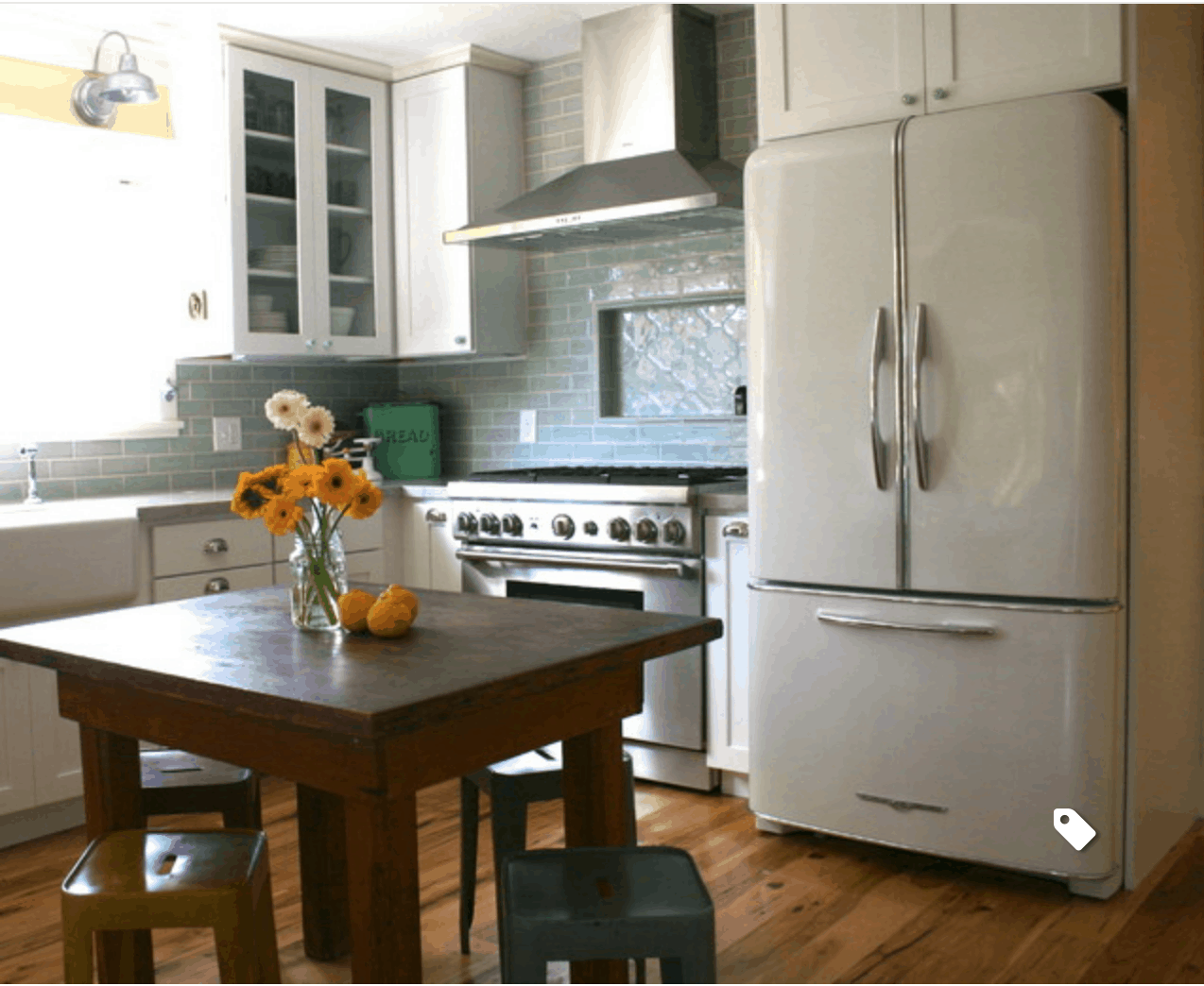Farmhouse kitchen with white fridge and stainless steel appliances