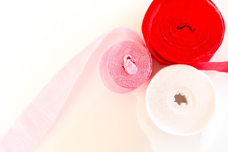 Red, pink, and white crepe paper streamers - for Valentines' Day wall decor