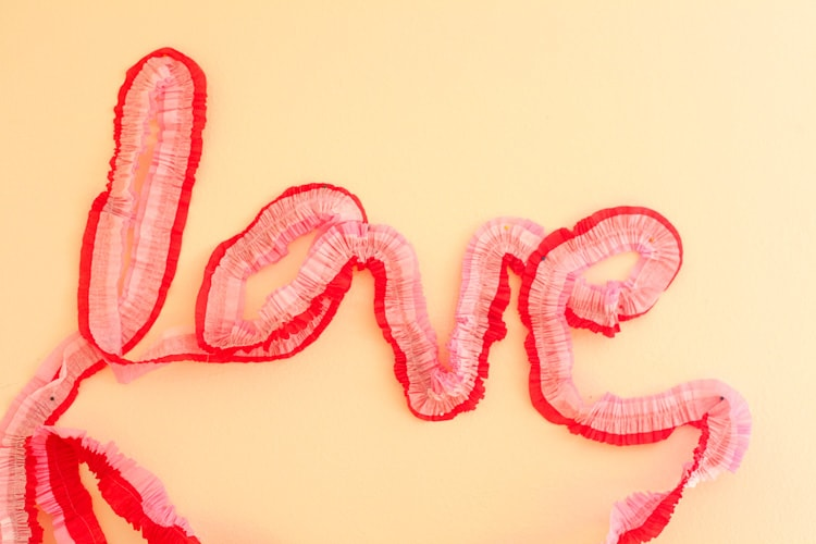 What a cool way to use crepe paper to decorate for Valentine's Day! Totally doing this, they are like $1 each! Love!
