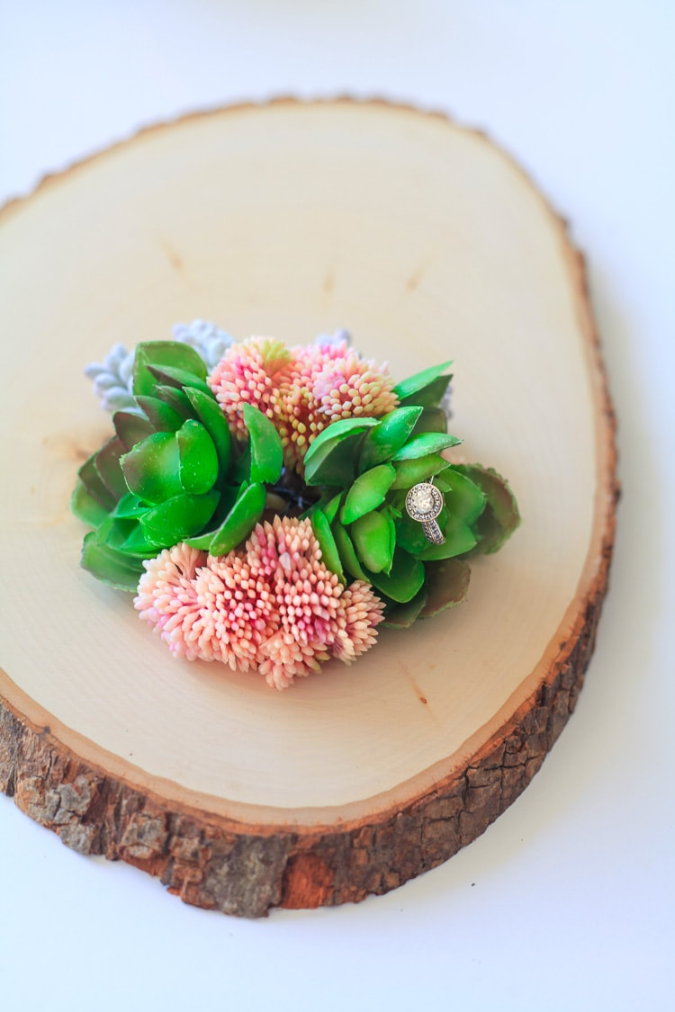 This diy faux succulent and wood centerpiece is gorgeous for a wedding, party or spring decor!