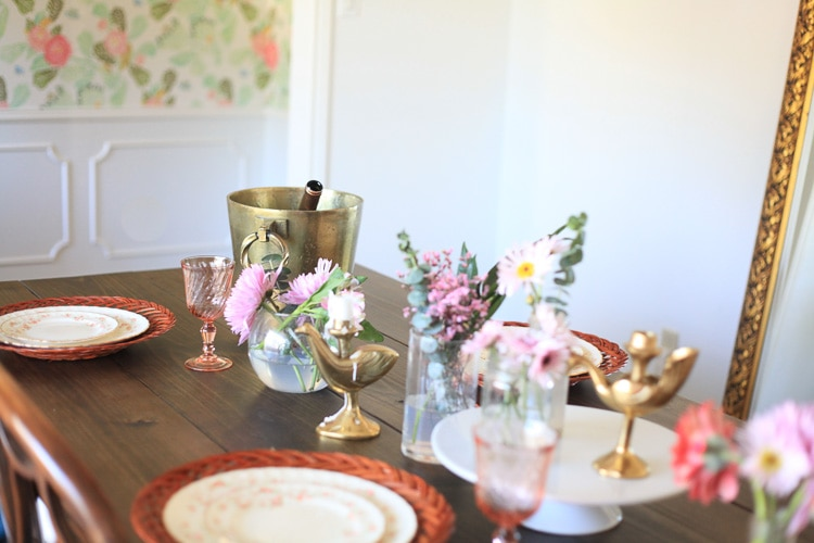 A kitchen table surface set with Spring decor and gold accent pieces.