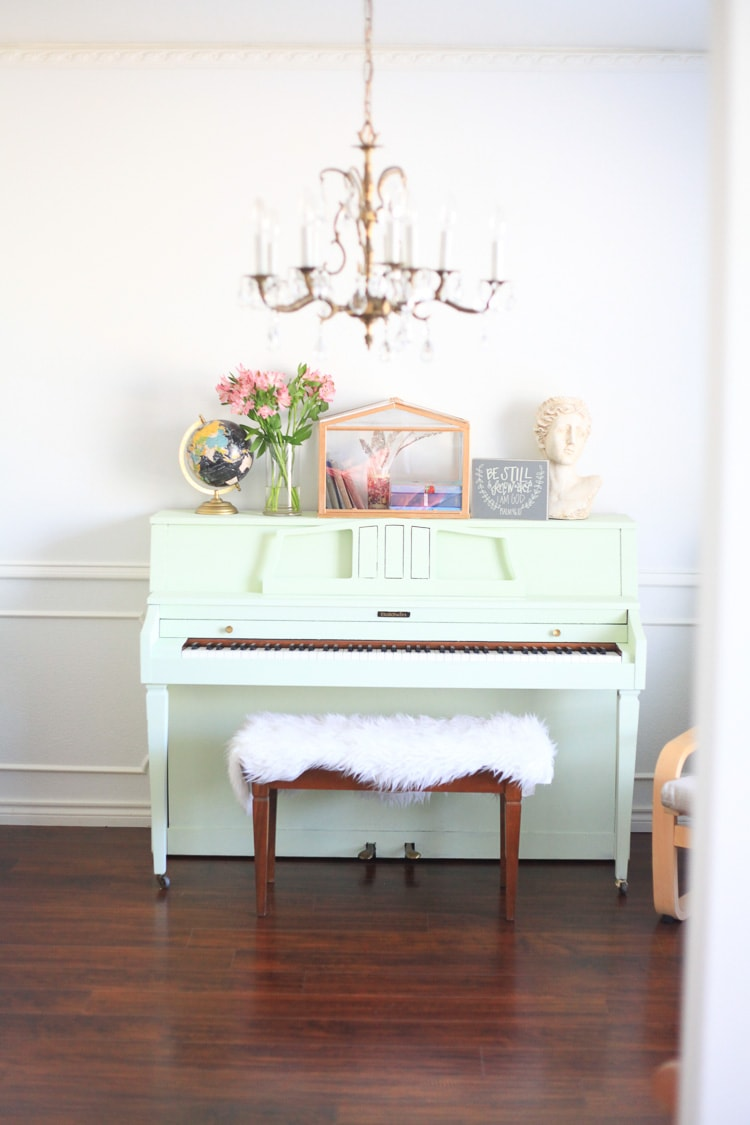 A DIY painted piano topped with fresh pink flowers in a vase for this Spring home tour.
