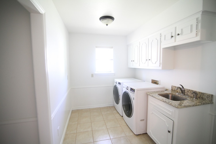 It's amazing what a few coats of white paint can do—this laundry room looks totally different!