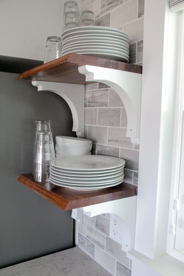 Small Kitchen Shelves With Stacked White Dishes And Glassware