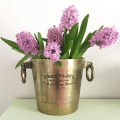 This is a fun way to display flowers - I like showing off flower arrangements like this better than a vase.
