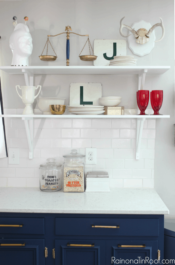 Eclectic kitchen shelves with white pottery and a gold scale