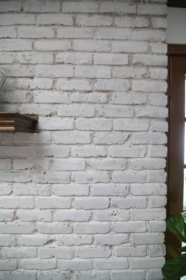 Close up of a whitewash brick fireplace