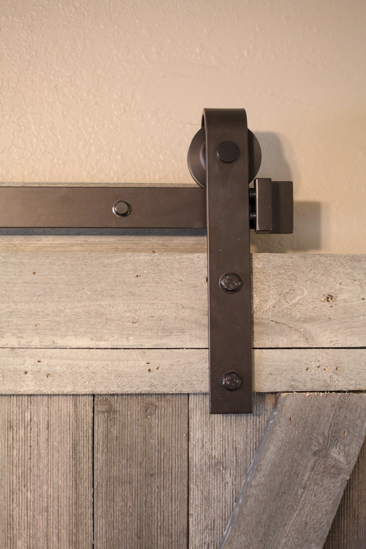 This easy to make rustic barn door is beautiful and easy to make! I love this for a touch of fixer upper style. Farmhouse is my favorite.