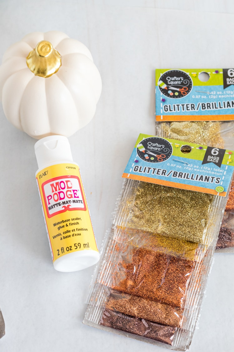 Supplies for diy glitter pumpkins - craft pumpkin, mod podge and fine glitter