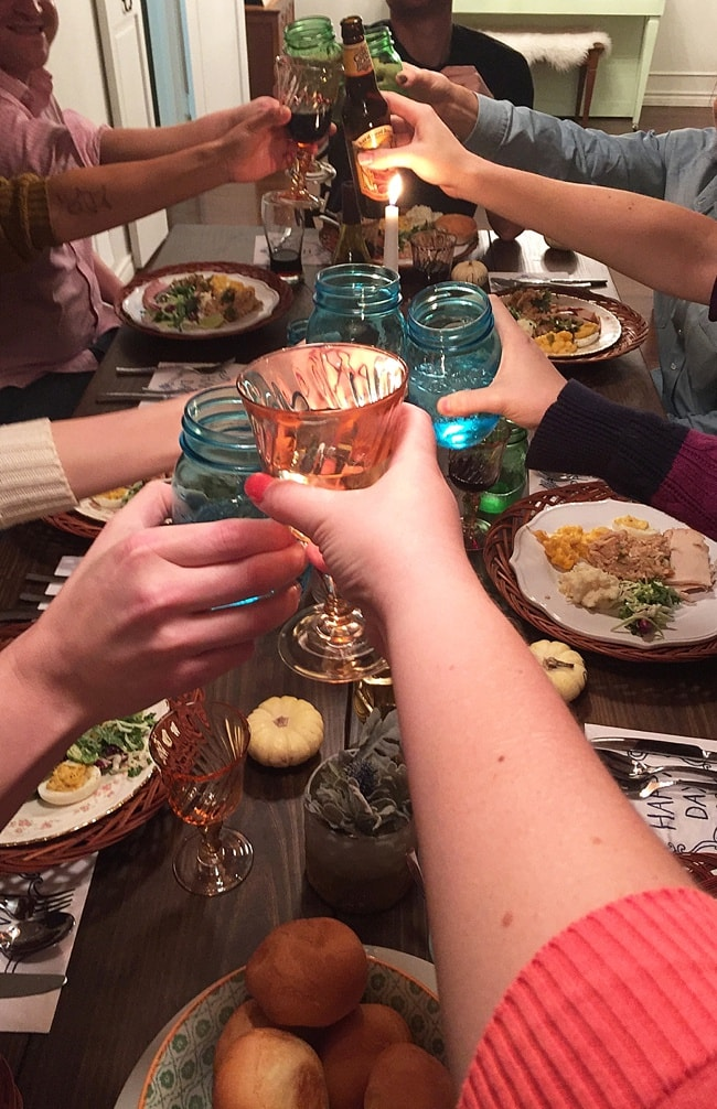 Saying cheers over Thanksgiving dinner.