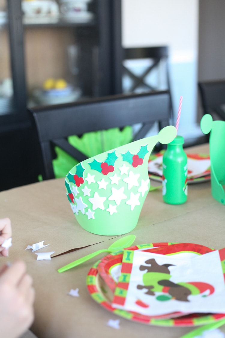 DIY create your own elf hat kit! I LOVE the idea of a kids Christmas table! This decor is so cute and the entire thing cost less than $100. I really want to do a Christmas table for kids this year!